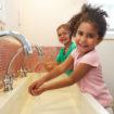 Pupils At Montessori School Washing Hands In Washroom