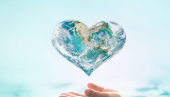 Saving water and environment care campaign concept with world in heart love shape: Elements of this image furnished by NASA